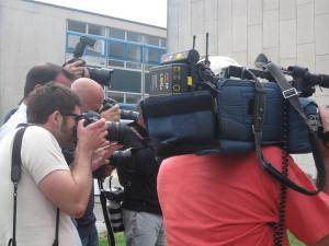 Photographers film campaigners outside Crawley Magistrates Court