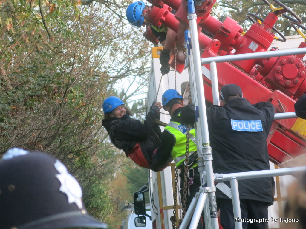 Campaigner abseils from rig lorry