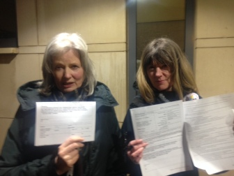 Sisters with charge sheets following arrest. Photo: Jon Mager