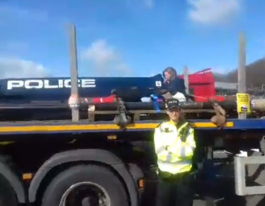 Women protester on lorry at Forton services on M6, 26 March 2018. Photo: Still from video by Darren Dennett