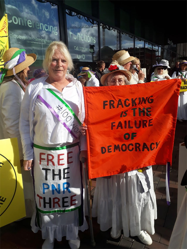 Anti-fracking campaigners dressed as suffragettes at the Conservative Party Conference in Birmingham, 1 October 2018. Photo: Friends of the Earth
