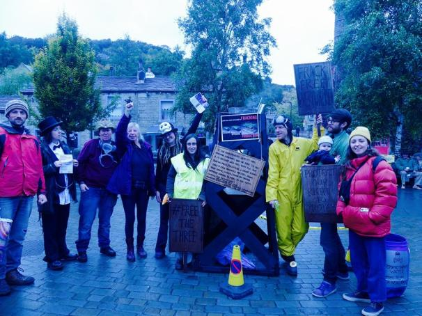 Street theatre, leafleting and a fracking rig in Hebden Bridge, 14 October 2018. Photo: DrillOrDrop
