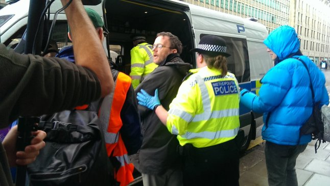 Father Martin Newell arrested at climate change protest at the Department of Business, Energy and Industrial Strategy, 12 November 2018. Photo: Christian Climate Action