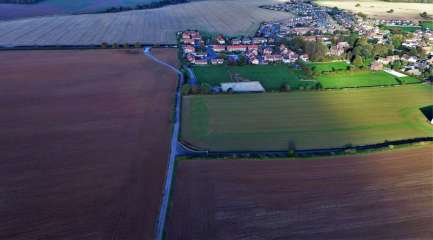 Aerial photo of the proposed Ineos shale gas site at Woodsetts (brown field on left of bridleway). Photo: Woodsetts Against Fracking