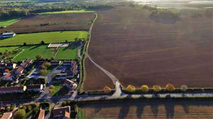 Aerial photo of the proposed Ineos shale gas site at Woodsetts (brown field on right of picture). Photo: Woodsetts Against Fracking